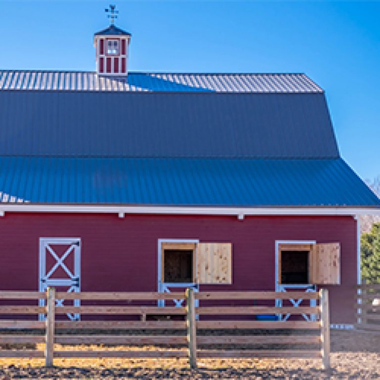 red post and beam barn for animals and parties